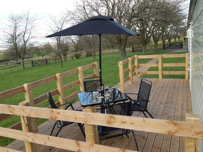 Relax on the South Facing Deck with a glass of wine while cooking on your own barbecue.