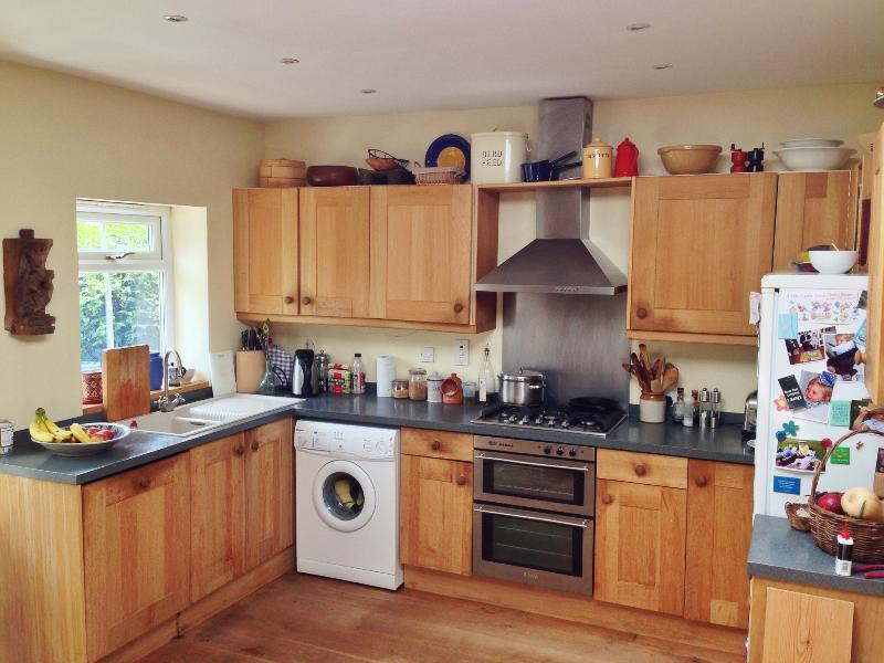 Overlooking the garden, the kitchen is large and well equipped