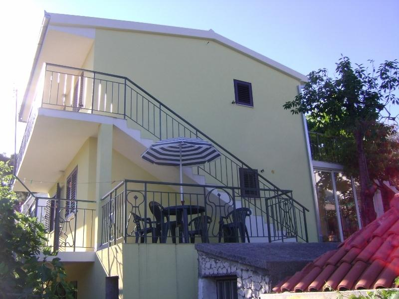 Villa from the side, (corner terrace and balconies)