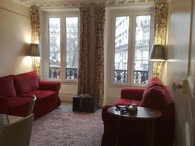 sitting room with large bright windows - overlooking square and park