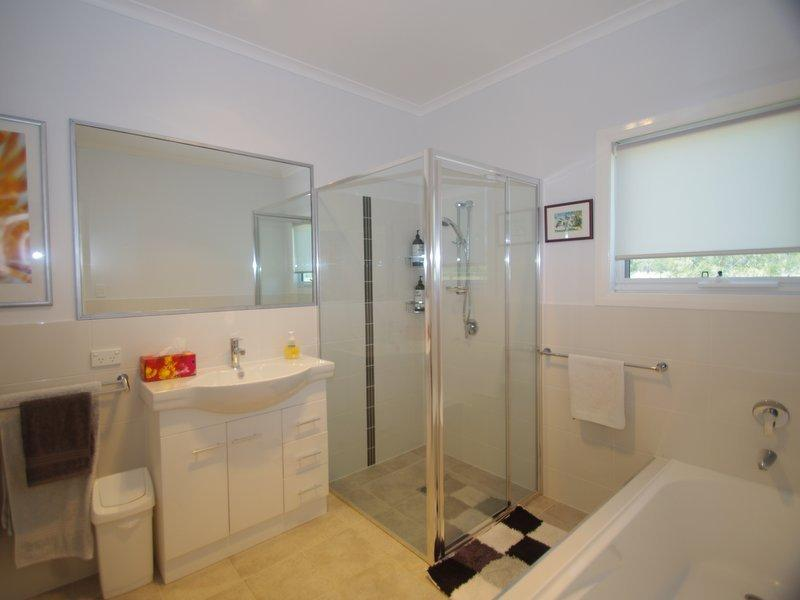 Luxuriously appointed bathroom and laundry.