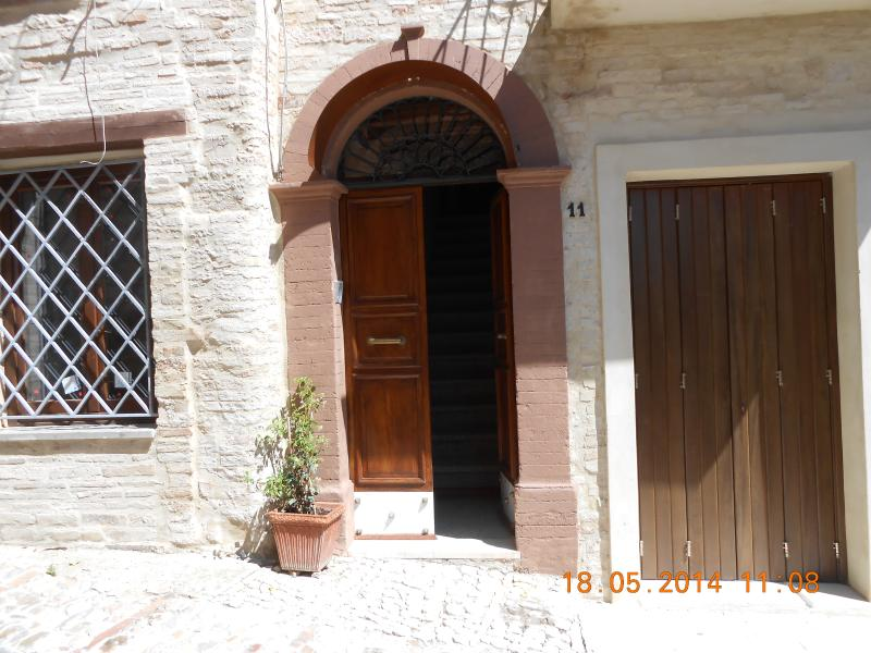 ARCHED ENTRANCE IS TYPICAL OF HOUSES OF THE OLD TOWN WITH ORIGINAL WALNUT GATE RESTORED