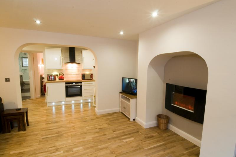 Wall mounted fire in addition to full central heating.