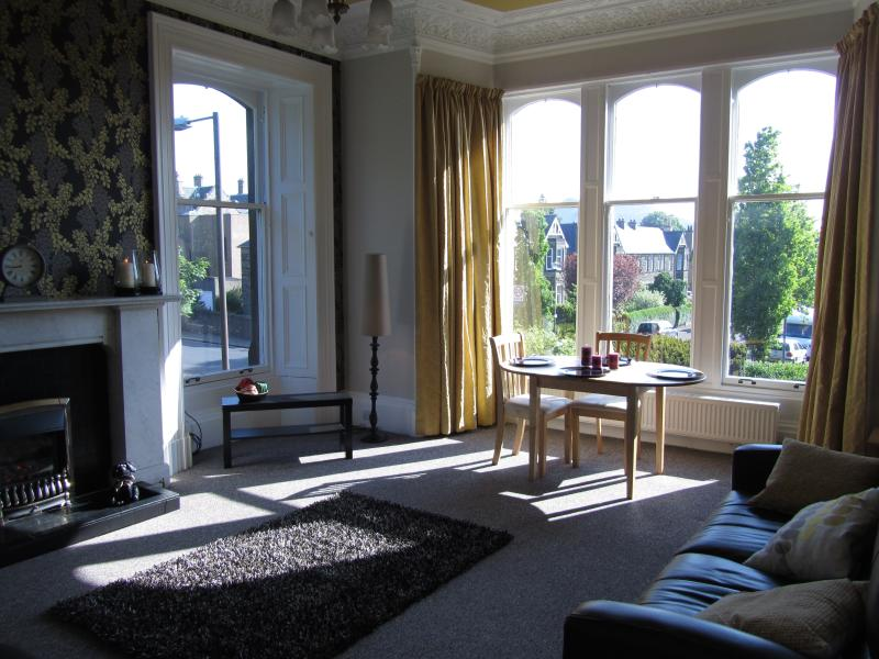 Bright and spacious lounge with views to Arthur's Seat and attractive gardens