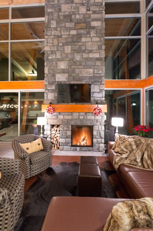 Living Area looking out to lake terrace. Terrace c/w large BBQ, exterior fireplace & lounge seat.