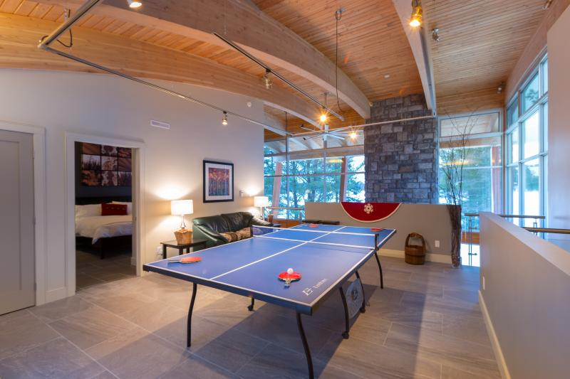 Second floor Recreation Room overlooks the Great Room c/w views up Otter Lake and down Serenity Bay.