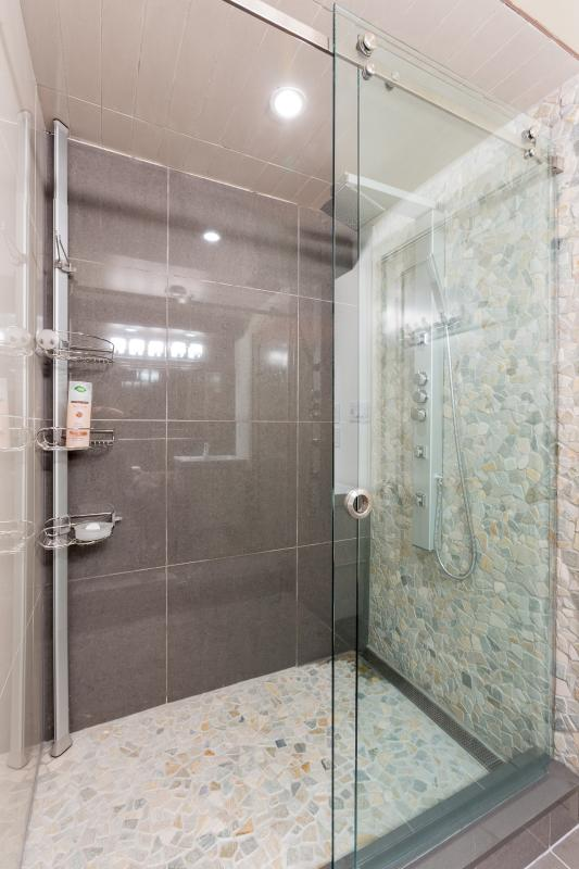 The second floor ensuite features a walk-in shower with massage jets and rain shower head.