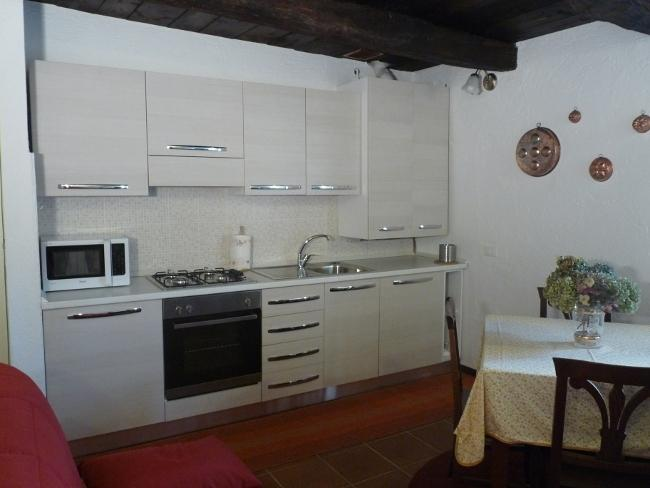 Kitchen/diner/living room. Kitchen with 4 burner hob, microwave, oven, dishwasher, fridge freezer