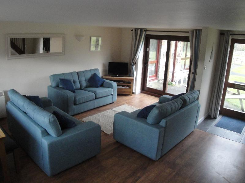 Spacious Lounge area with open area across Treglyn and rural views.