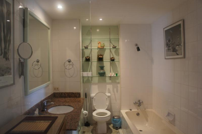 WC, Sink fitted in a Marble Countertop and a Bathtub with Shower