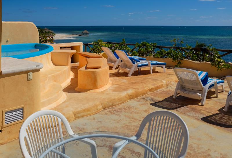 Rooftop terrace with jacuzzi and view over Caribbean.