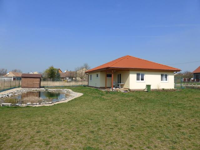 View of the bungalows of the garden side with a swimming pond