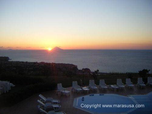 View from Marasusa of sun setting over Stromboli