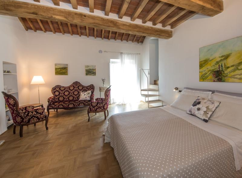 A 'wide and room, very private, quiet and comfortable, with works of art and fine furniture
