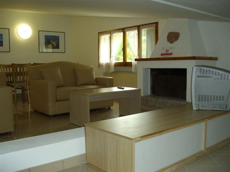 Romantic living room with fireplace of Residence Adriatica Cervia at seaside