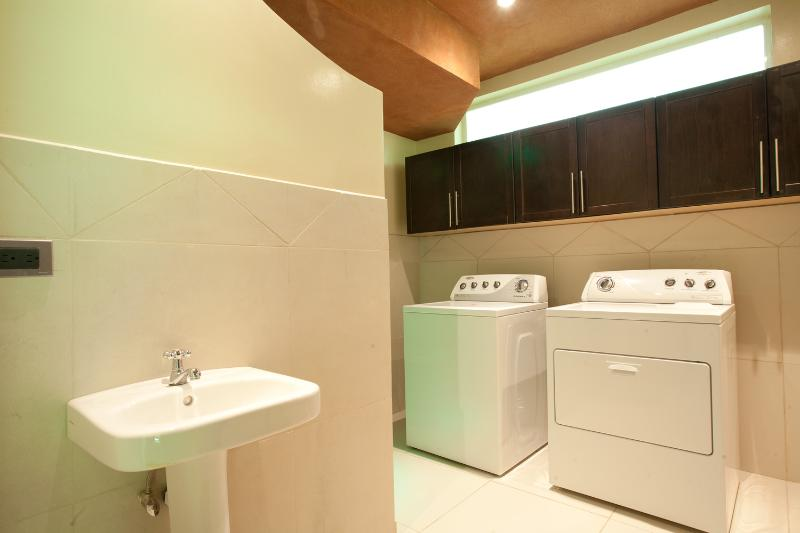 A utility room makes our vacation rental home convenient, especially for those traveling with kids.