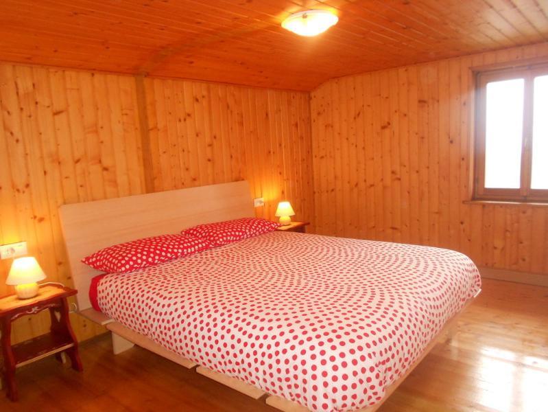 cama de casal no sótão