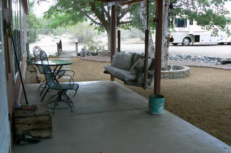 Back porch, table w/ 2 chairs, swing