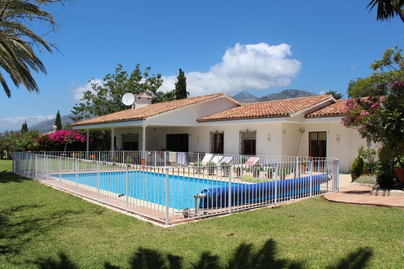 The Villa and surrounding garden with Pool