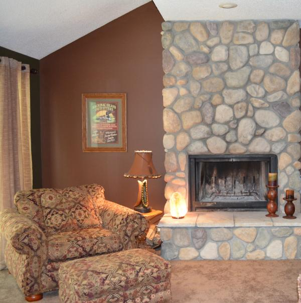 All natural field stone fireplace anchors a very comfortable living room