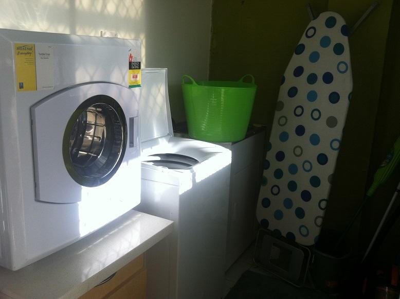 Laundry has washing machine and clothes dryer