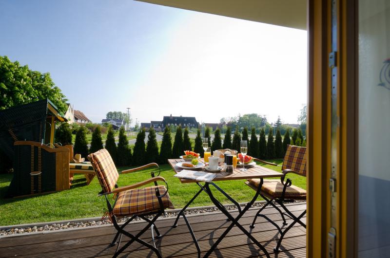Terrasse avec mobilier en teck