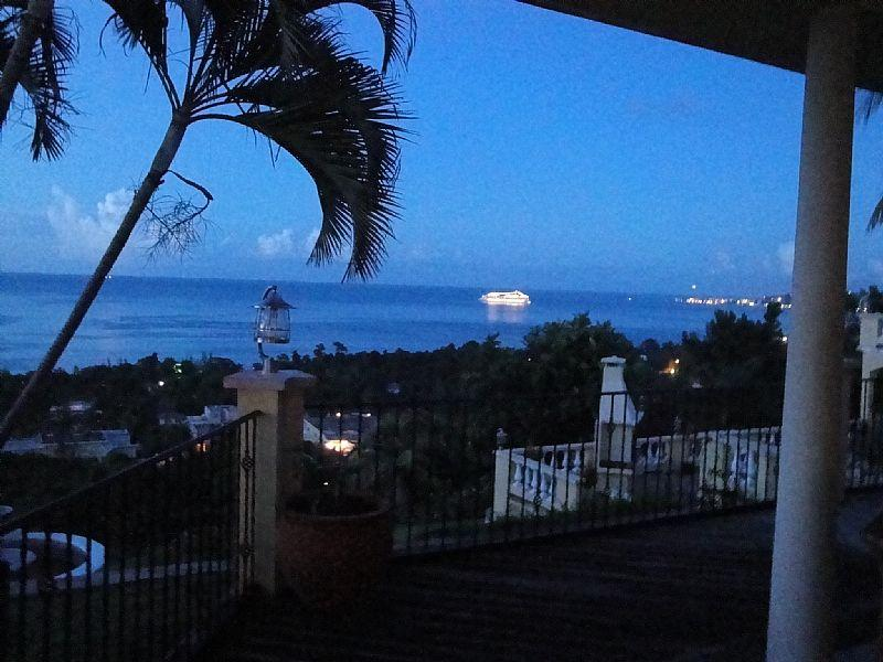 View of a passing Cruise Ship from the patio at sundown