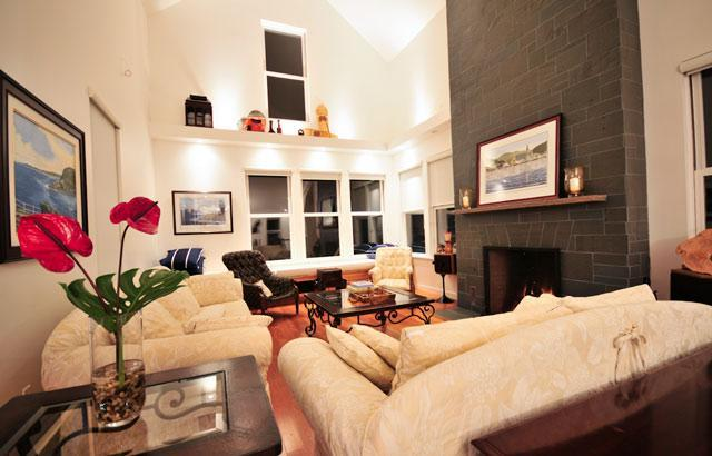 The main living room houses a custom-built Rumford fireplace, and deep couches for reading.