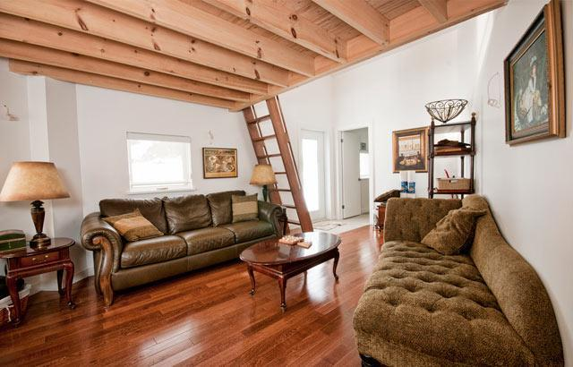 A second living area includes separate stereo system, a satellite television, games & arts supplies