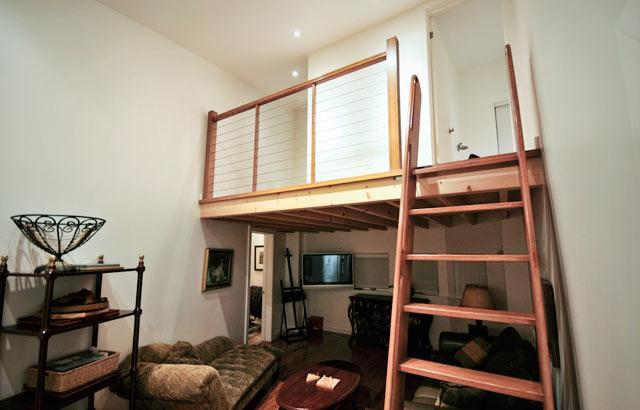 These lofted bedrooms are accessible from the living area via shipman's ladder.
