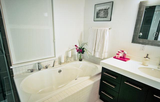 Three bathrooms are fitted with showers, towels, and toiletries.