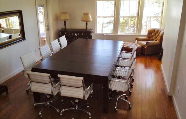 For work and play: the lower level boardroom table also converts to a pool table.