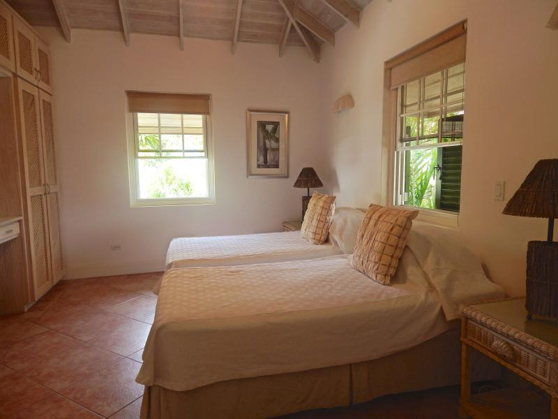 Second bedroom - large twin beds with en-suite bathroom