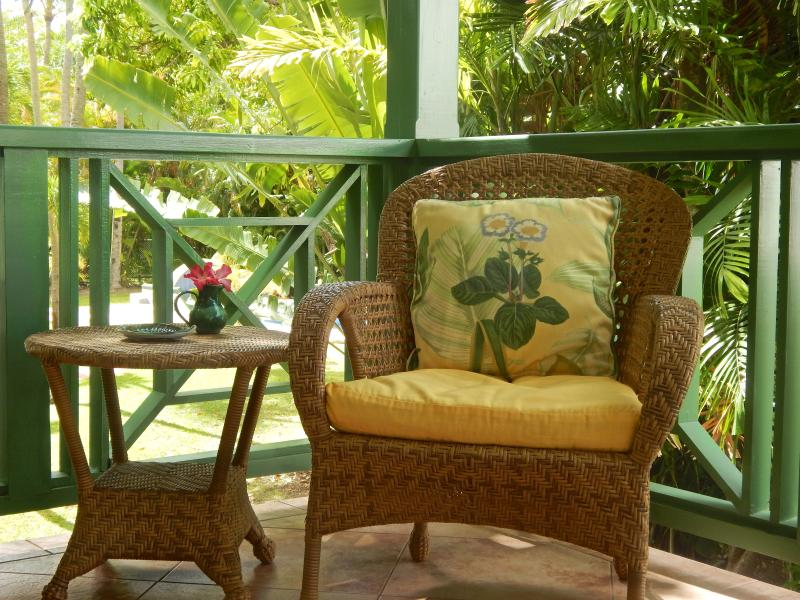 Relax on the veranda with views of the grounds and pool