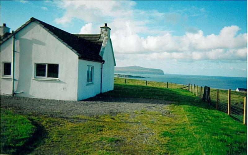 comfortable  cottage with truly amazing views West across the sea , sunrise and sunsets to die for !