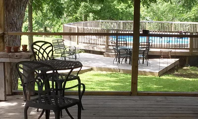 View of the pool from the screened hot tub room.