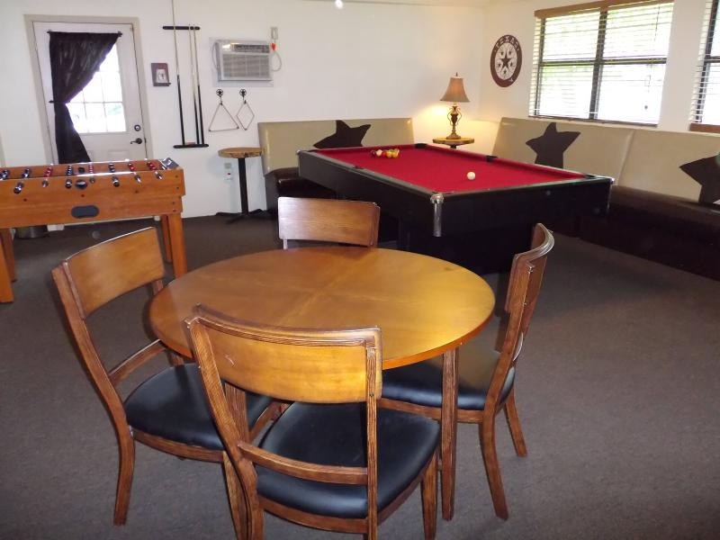 Game room with Foosball, pool, and game tables.