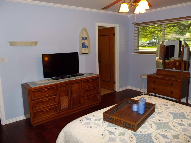 Master bedroom vanity area. All rooms have flat screen TVs and DVD players.