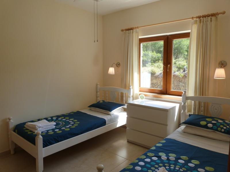 Twin bedroom with fitted wardrobe, chest of drawers for plenty of storage space.
