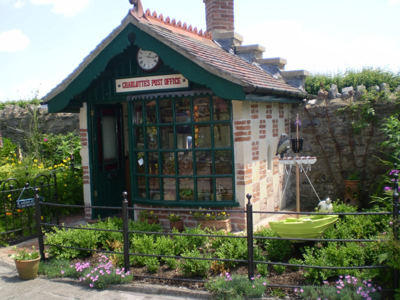 The Owl and the lovely Cat & the Pea Green Boat in the Post Office garden. The Box Hedge is the sea.