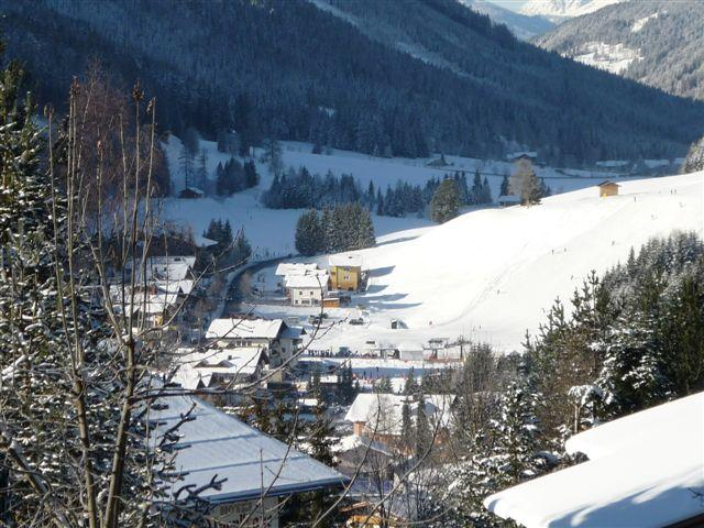 Winter view of our beautiful village Filzmoos from chalets