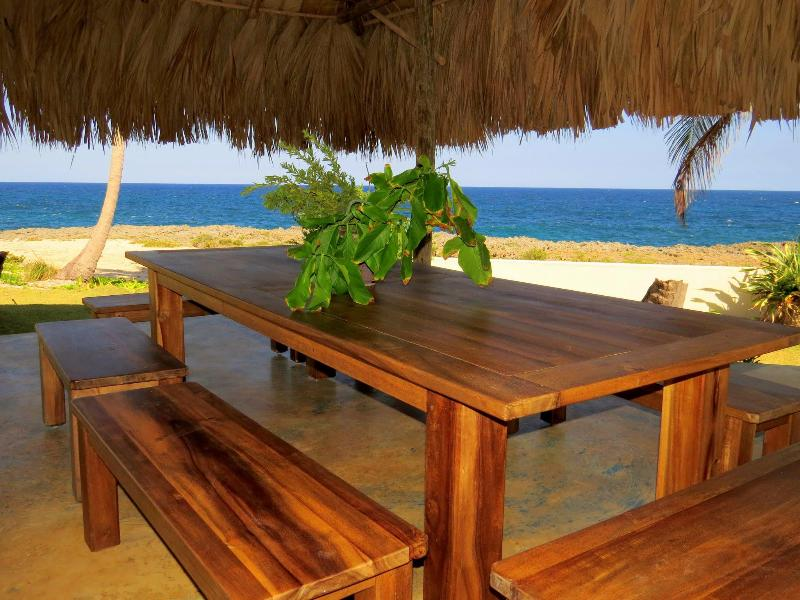 Enjoy the view from Villa Punta Coral while dining under the shaded terrace.