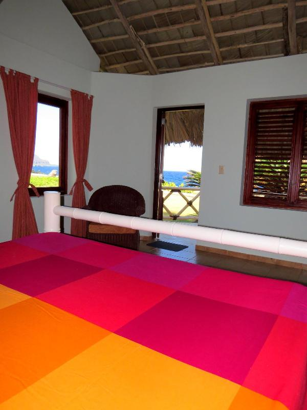 You can see the ocean from the beds in both master bedrooms of Villa Punta Coral.
