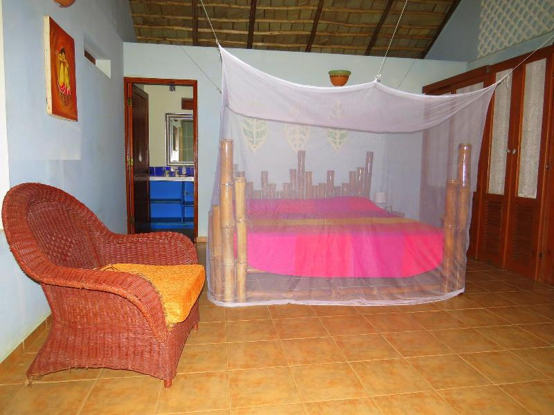 The villa has 2 master bedrooms with king-sized beds. Each has an overhead fan and mosquito net.