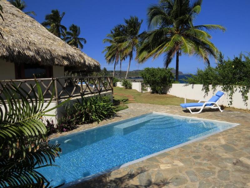 The pool and outdoor seating areas at Villa Punta Coral are very welcoming and comfortable.