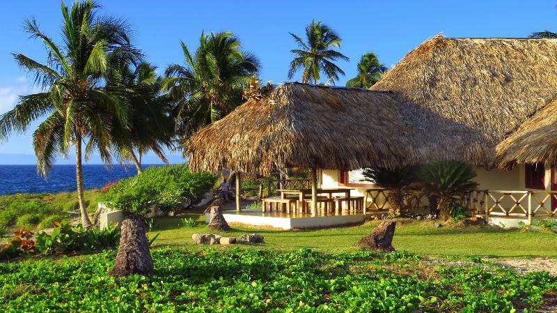 There is a very comfortable thatch-roofed seating area with a great ocean view.