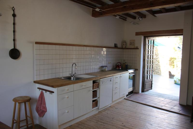Kitchen, view 2  leading to courtyard