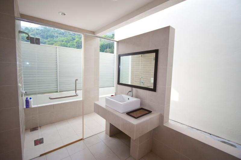 Open, ensuite bathroom of the 5th bedroom. The lush mountain behind exudes clean mountain air.