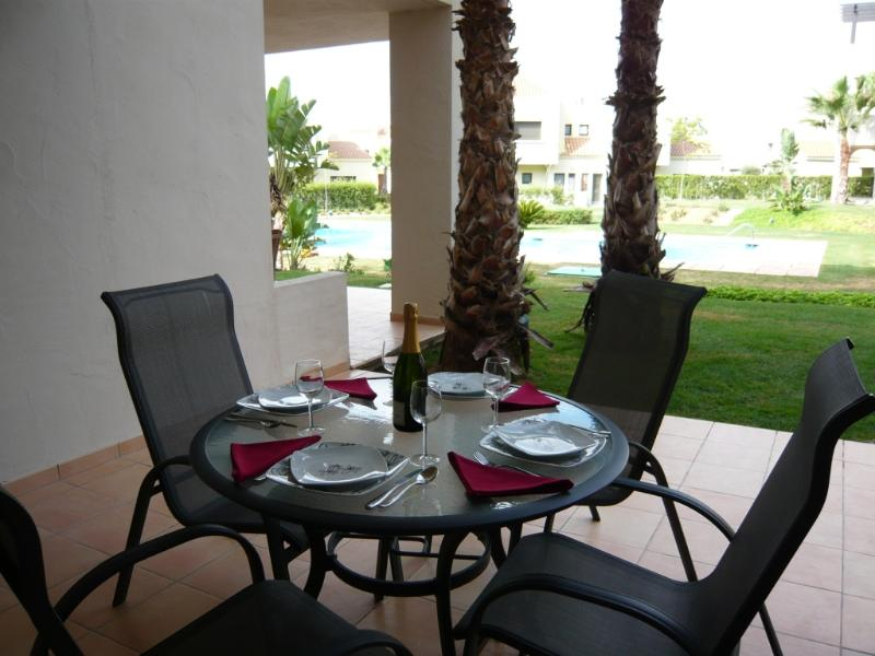 Dine in style overlooking the pool and gardens