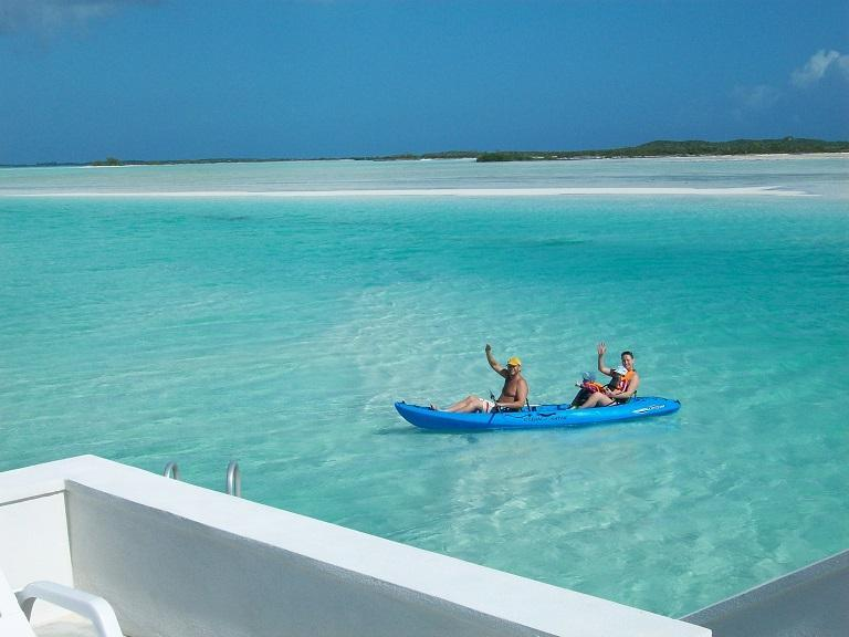 Guests enjoying a kayak ride back from Man-O-War Cay.